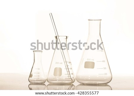 Group of laboratory flasks empty or filled