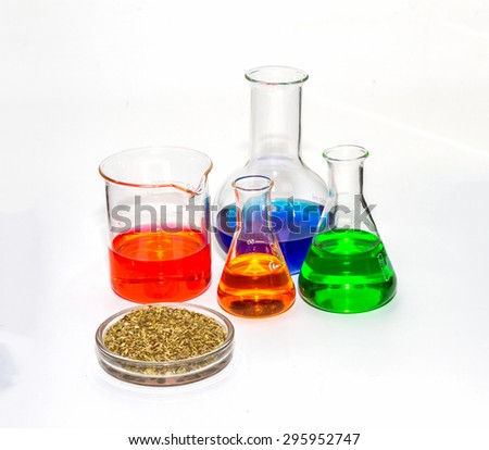 Group of laboratory flasks with liquid inside on white backgrond.