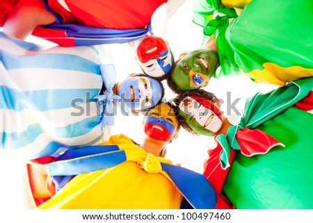 Group of Latin people with flags painted on their face - stock photo