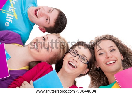 Group of laughing students with exercise books together