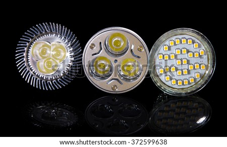 Group of 3 LED lamps isolated on black - stock photo