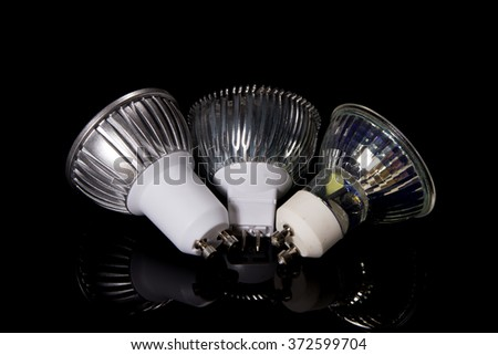 Group of 3 LED lamps turned back to camera isolated on black - stock photo