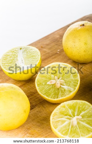 group of lemons isolated on wood