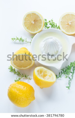 Group of lemons on the white table ready to be squeezed