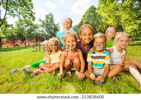 Group of little boys and girls on the lawn - stock photo