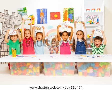 Group of little kids in early development lesson - stock photo
