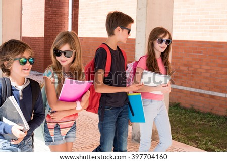 Group of little kids walking at School Campus - stock photo