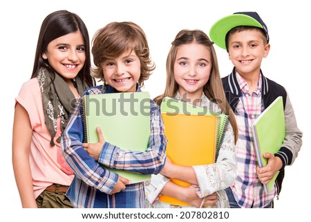 Group of little students over white background - stock photo