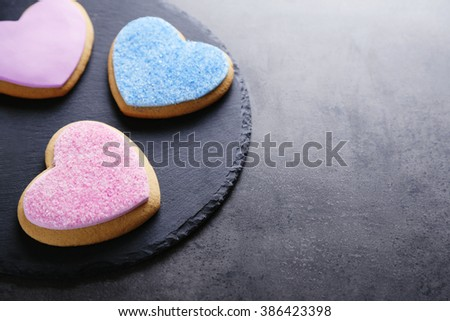 Group of love cookies on grey background - stock photo