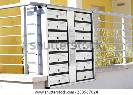 group of mailboxes and intercom - stock photo