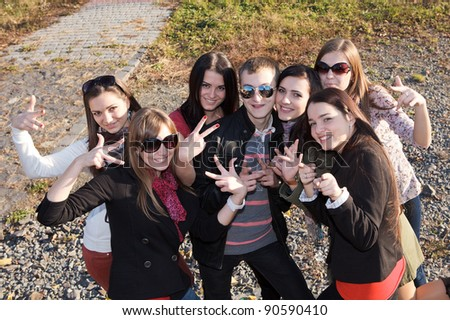 Group of male and female students in park - stock photo