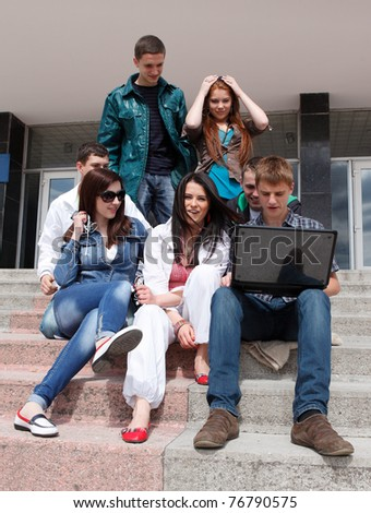 Group of male and female students inside an academic building