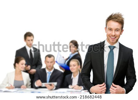 Group of managers discussing while sitting at the table, isolated on white. Concept of teamwork and cooperation - stock photo