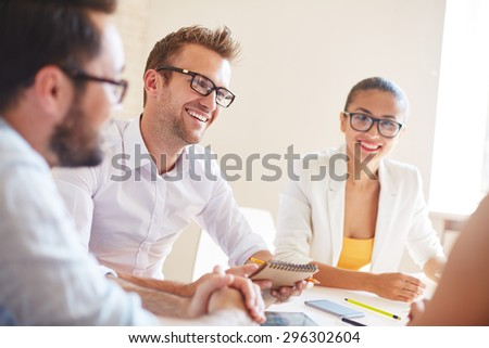 Group of managers planning work and interacting at meeting - stock photo