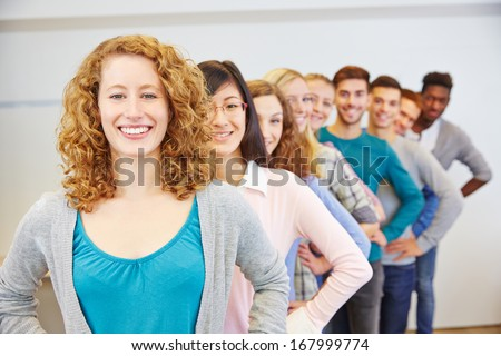 Group of many happy teenager in a row behind each other - stock photo
