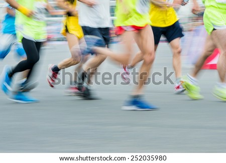 group of marathon runners compete in the race, blurred motion - stock photo