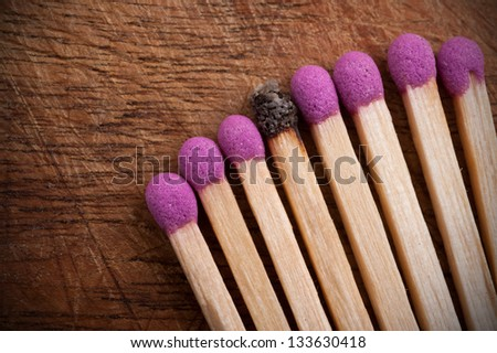 Group of matchsticks on wooden table. - stock photo