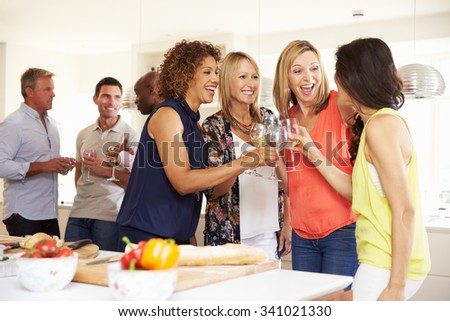 Group Of Mature Friends Enjoying Dinner Party At Home - stock photo