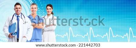 Group of medical doctors over blue hospital background. Health care