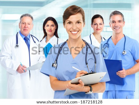 Group of medical doctors over hospital background - stock photo