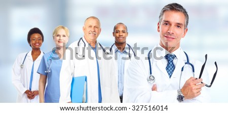 Group of medical doctors over hospital background. Health care.