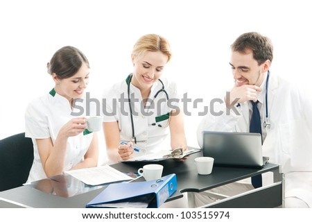 Group of medical workers discussing in office - stock photo