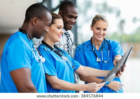 group of medical workers looking at patient's x-ray  - stock photo