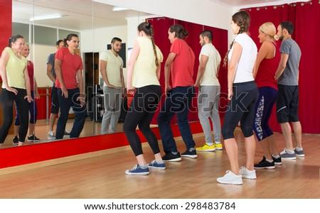 Group of men and women exercising in dance studio - stock photo