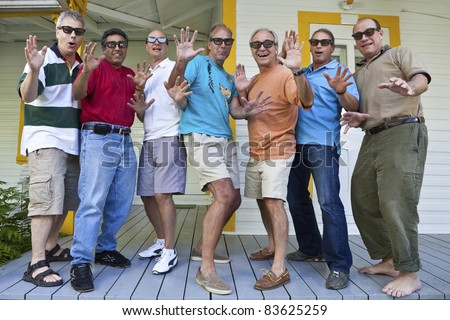Group of men looking impressed - stock photo
