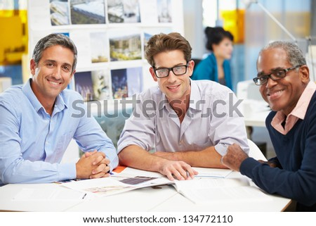 Group Of Men Meeting In Creative Office - stock photo