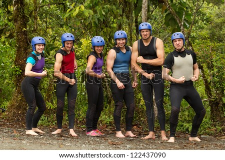GROUP OF MEN'S AND WOMEN SHOWING OFF THEIR MUSCLES  - stock photo