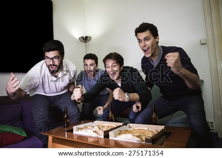 watching football stock images royalty images vectors group of men sitting on sofa watching sport together