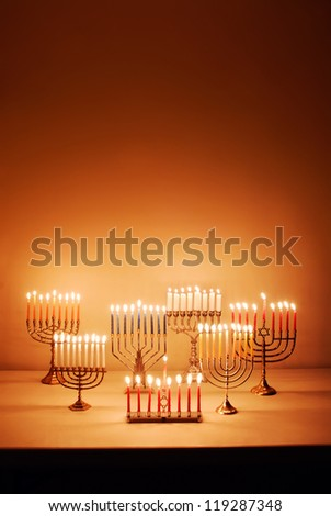 Group of menorahs lit for Hanukkah - stock photo