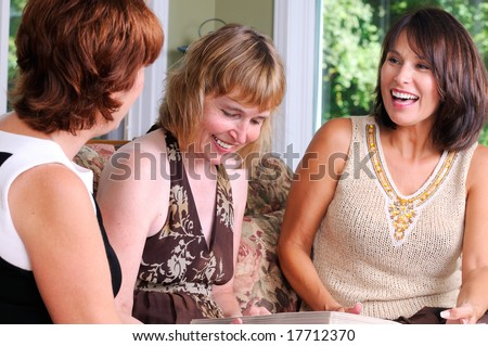 Group Of Middle Age Friends Getting Together For Some Fun - stock photo