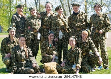 Group of military women and man in uniform together outdoors - stock photo