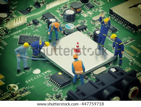 group of mini mechanic work on mainboard and CPU , they try to open chip for repair - can use to display or  montage on product - stock photo