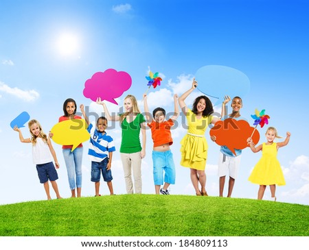 Group of Mixed Age Holding Colorful Speech Bubbles in a Summer Concept Photo
