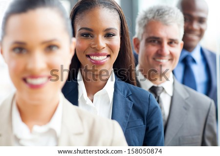 group of modern multiracial business people in a row - stock photo