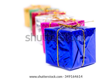 Group of multi colored boxes with christmas gifts