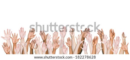 Group of Multi-ethnic and Diverse Hands Raised - stock photo
