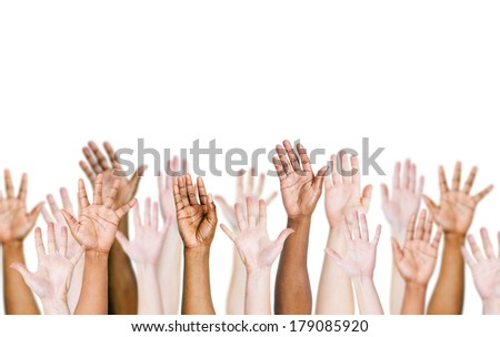 Group of multi-ethnic and Diverse Hands Raised Up - stock photo