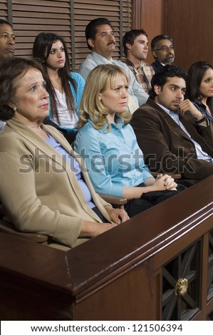 Group of multi ethnic business people sitting together in courthouse - stock photo