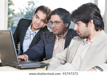 group of multi ethnic businessmen, indian businessman in a meeting with his colleagues - stock photo