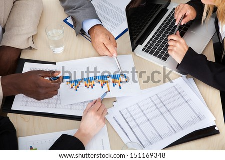 Group Of Multi Ethnic Businesspeople Discussing Plan In Office
