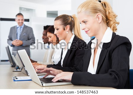 Group Of Multi Ethnic Businesspeople Working Together In Office
