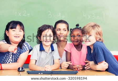 Group of multi ethnic children studying in elementary classroom.