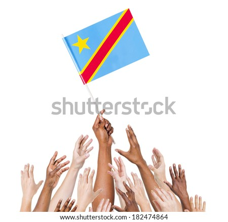 Group Of Multi-Ethnic People Reaching For And Holding The Flag Of Democratic Republic Of The Congo - stock photo