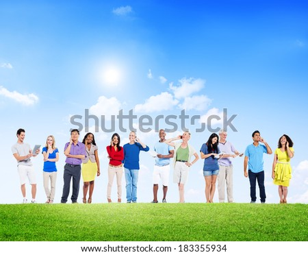 Group Of Multi-Ethnic People Social Networking Outdoors