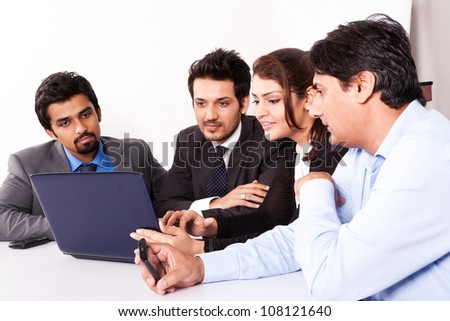 group of multi racial business people in meeting - stock photo