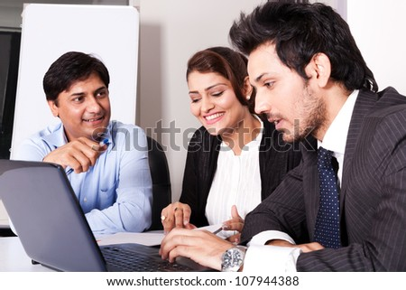 group of multi racial business people in meeting, Indian business woman in meeting with young businessmen. - stock photo